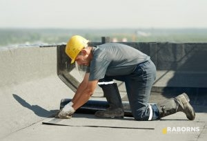 Roofer Performing Commercial Roof Repair