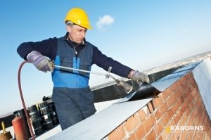 Roofer Completing Flat Roof Repair