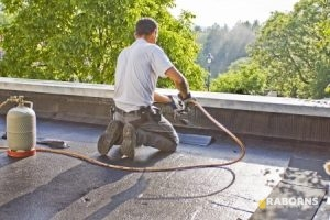 Man Repairing Single Ply Roofing Materials