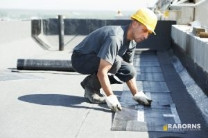 Roofer Finishing Flat Roof Repair