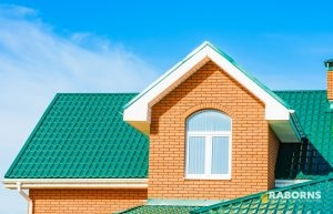 House with Green Metal Roofing Shingles