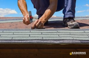 Roofer Installing Residential Roofing Materials