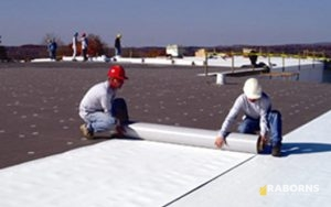 Workers Installing PVC Roofing Materials