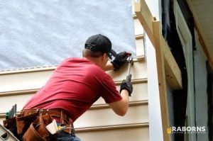 Working Installing Vinyl Siding