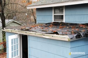 House with Roof Storm Damage