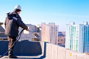 Commercial Roofer Repairing the Roof