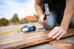 Worker Completing Deck Repair