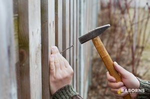 Man Completing Fence Repair