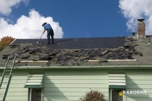 One Roofer on a Roof Engaged in Roof Replacement