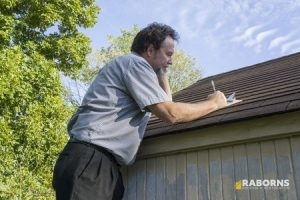 Roof Damage Insurance Claims Adjuster Inspecting a Roof