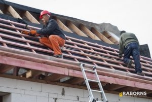 Two Roofers Employed at Roof Replacement.